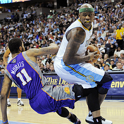 Al Harrington adds 23 points for the Nuggets, who take sole possession of seventh place in the West with their win.  (AP)