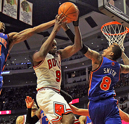 The Bulls' Luol Deng battles through the Knicks for 19 points and 10 rebounds. (Getty Images)
