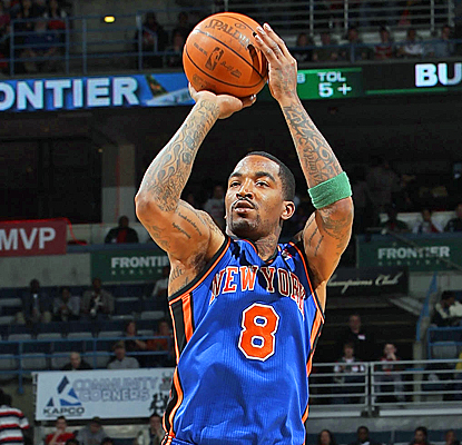 J.R. Smith drills a 3-pointer with 64 seconds left  to help the Knicks stay ahead of the Bucks in the race for 8th in the East. (Getty Images)