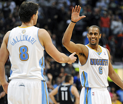 Arron Afflalo (right) and Danilo Gallinari celebrate as the Nuggets pick up their second straight win. (AP)