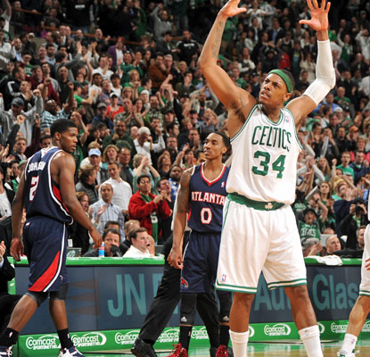 Paul Pierce hits a big jumper in overtime to guide the tired Celtics to a hard-fought win over the Hawks.  (Getty Images)
