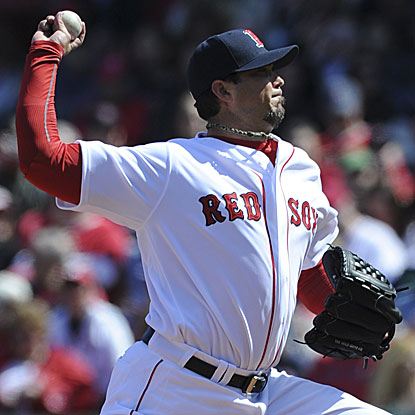 Josh Beckett allows one earned run on five hits in eight innings to win the Red Sox's eighth consecutive home opener.  (US Presswire)