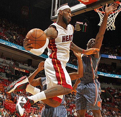 LeBron James narrowly misses a double-double with 19 points and nine rebounds as the Heat cruise.  (Getty Images)