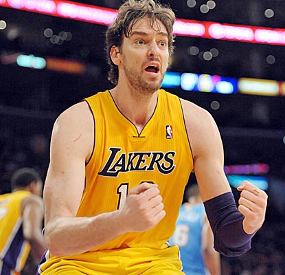 Pau Gasol notches a double-double (14 points and 10 boards) as the Lakers clinch a playoff berth.  (US Presswire)