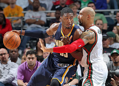 The Bucks struggle to slow down Roy Hibbert. The Pacers' big man finishes with 23 points and 14 boards. (Getty Images)