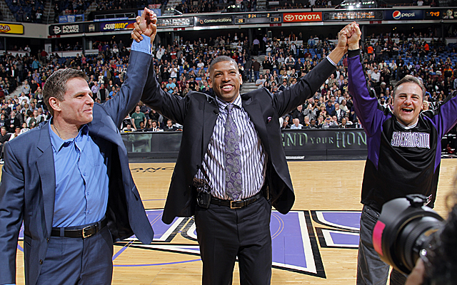 Joe and Gavin Maloof flank mayor Kevin Johnson to celebrate a joint agreement in February. (Getty Images)