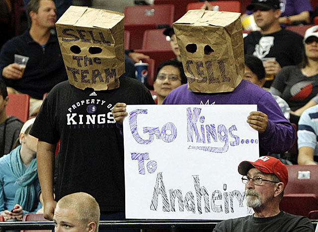 Fans protesting the Maloofs' recent moves were scattered throughout Sunday's game crowd. (AP)