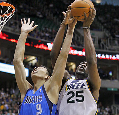 Al Jefferson battles for one of his career-high 26 rebounds. He also finishes with 28 points in Utah's triple overtime win. (AP)