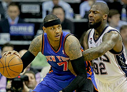 Carmelo Anthony finishes with 33 points -- including 21 in the opening quarter -- on the Nets. (US Presswire)