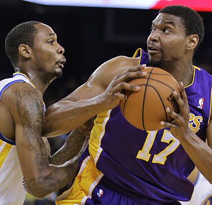 Mickell Gladness has no luck containing Andrew Bynum, who goes off for 31 points and nine boards in the Lakers' win. (AP)