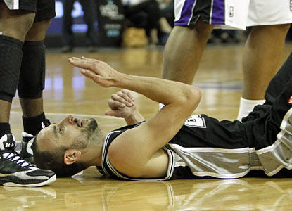 Manu Ginobili plays limited minutes, but still finds time to take a couple of bumps before finishing with 13 points. (AP)