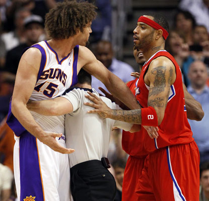 Robin Lopez and Kenyon Martin tangle in an intense game that features 24 lead changes.  (AP)
