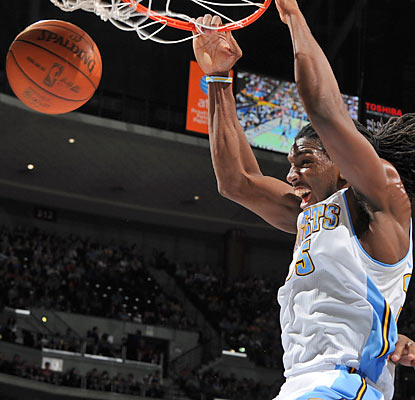 Kenneth Faried drops in 11 points along with a team-high 10 rebounds in a blowout win over Orlando. (Getty Images)