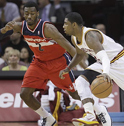 In a matchup between the past two No. 1 overall draft picks, John Wall (2) dazzles while Kyrie Irving plays only 10 minutes.  (AP)