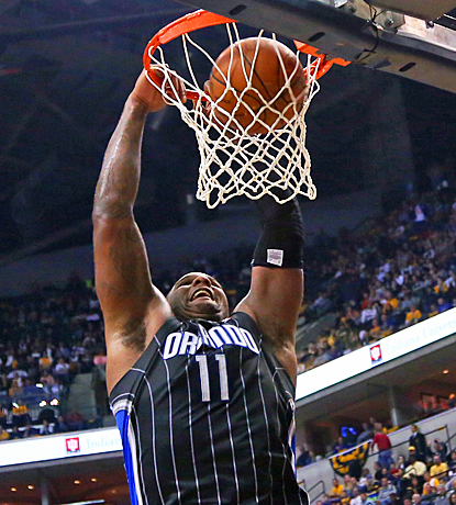Glen Davis does his best to help the Magic draw first blood by scoring 16 points with 13 rebounds. (US Presswire)