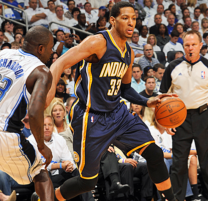 Danny Granger dances around the Magic's defense for 26 points and nine rebounds for the Pacers. (Getty Images)