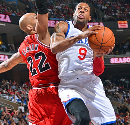 Andre Iguodala absorbs contact as he attacks the basket in the 76ers' comeback victory over the Bulls.  (Getty Images)