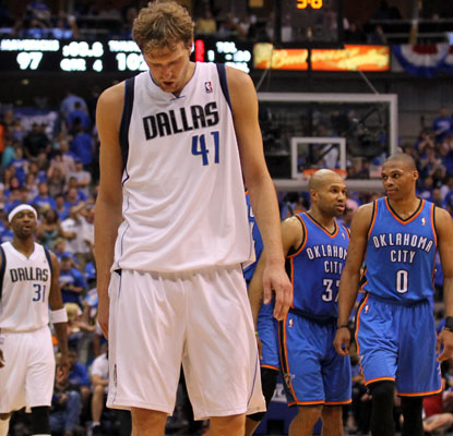 Dirk Nowitzki and the Mavericks are the first defending champs to get swept since the Heat in 2007.  (US Presswire)