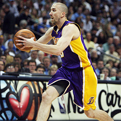 The Lakers' Steve Blake drills a 3-pointer in the game's closing seconds to hold off the Nuggets.  (US Presswire)