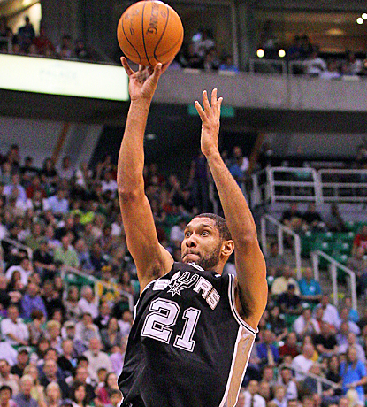 Tim Duncan fires a shot as he scores 11 points in the Spurs' series-clinching win against the Jazz. (AP)