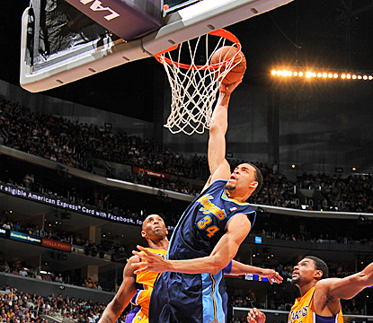 The Nuggets' JaVale McGee goes up for a dunk, scoring two of his 21 points against the Lakers in Game 5. (Getty Images)