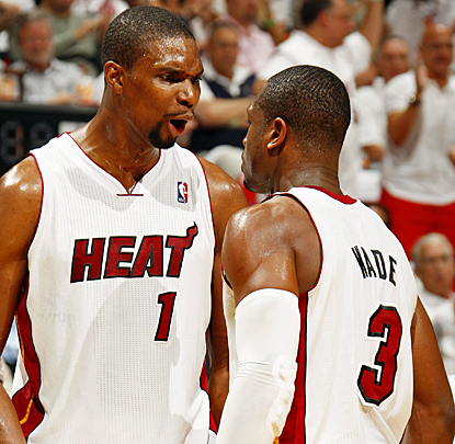 Chris Bosh (left) celebrates with Dwyane Wade as the Heat make short work of the Knicks in their series-clinching win. (Getty Images)