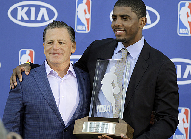 Irving accepts his Rookie of the Year trophy with Cavs owner Dan Gilbert. (AP)