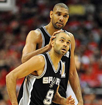 Tim Duncan, who scores 19 points, pats teammate Tony Parker (24 points) on the head as the Spurs rally to win Game 3. (US Presswire)