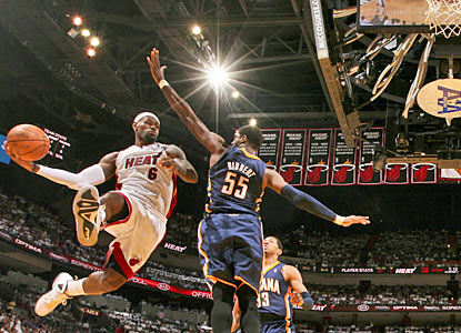 LeBron James (30-10-8) demonstrates why he is MVP. The Heat's superstar finishes two assists shy of a triple-double. (Getty Images)