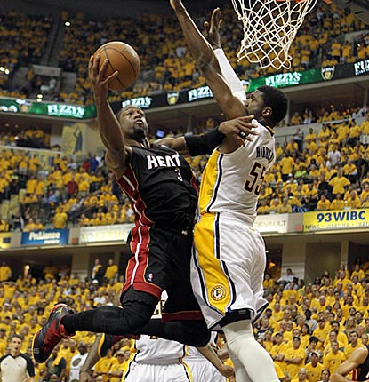 Dwyane Wade takes it to Roy Hibbert in the first half. Wade scores 20 of his 41 points in the second quarter.  (US Presswire)