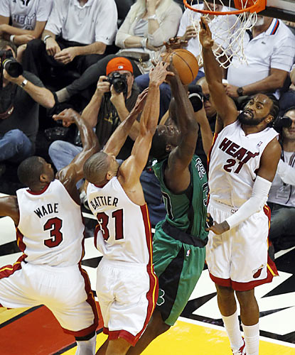 The Heat stifle the Celtics with a swarming defense that helps keep Boston below 40 percent shooting from the field. (AP)