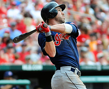 Jason Kipnis follows through on his three-run shot in the top of the ninth to help the Indians drop the Cardinals. (Getty Images)