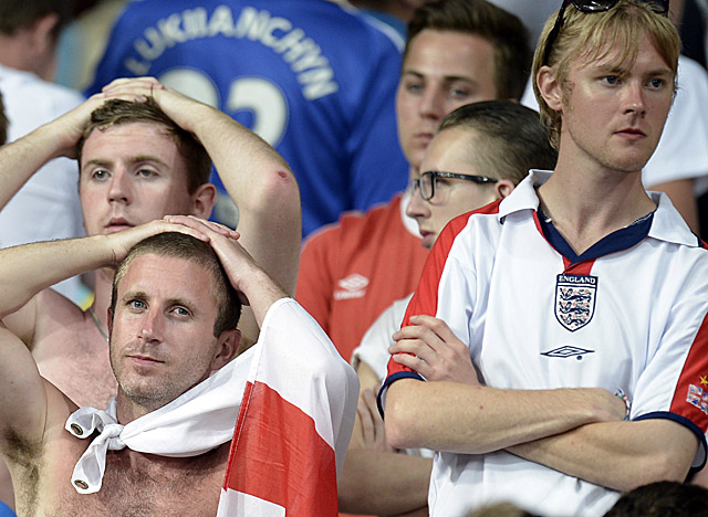 English fans are exasperated after England falls to Italy in the Euro quarterfinals. (AP)