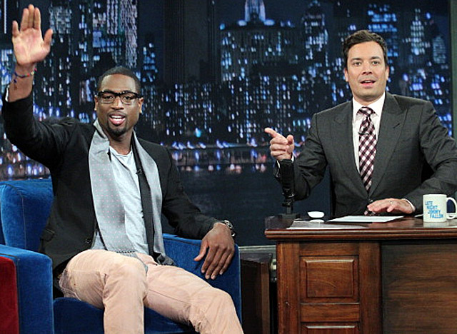 After winning the NBA title, Wade, here on Jimmy Fallon's show, made the celeb circuit. (Getty Images)