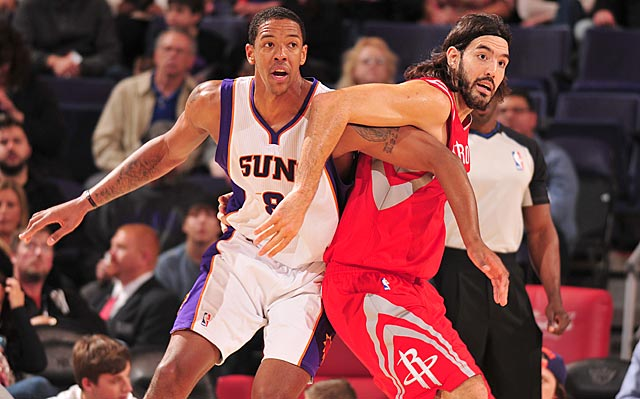Channing Frye (left) and Luis Scola will be battling again soon, only as teammates in practices. (Getty Images)