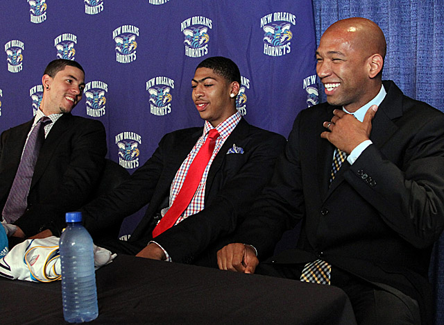 Williams, here with Anthony Davis and Austin Rivers, heads into his third season coaching the Hornets. (US Presswire)