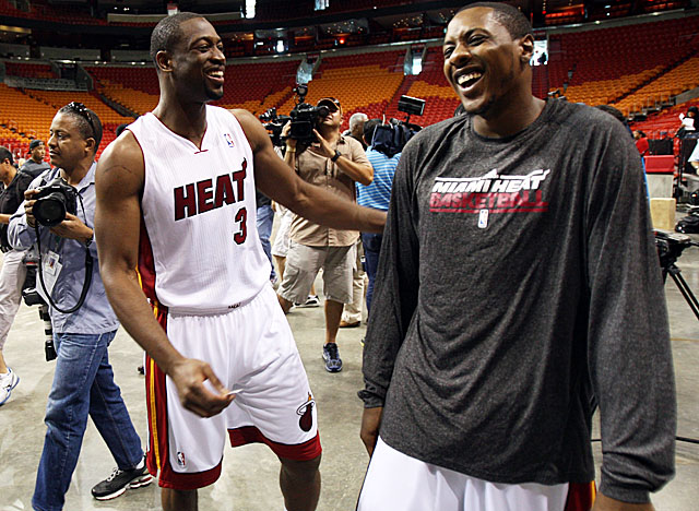 Wade, here at media day with teammate Mario Chalmers, may not be ready to open the season. (AP)