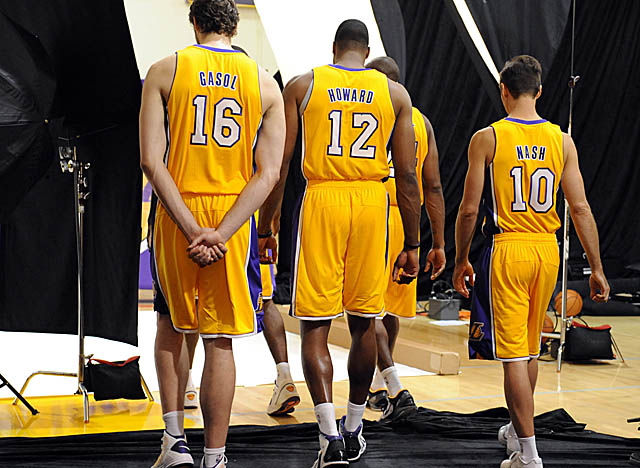 Kobe Bryant, here in front of Dwight Howard, again has big talent to back him up in L.A. (US Presswire)