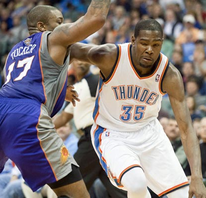 Kevin Durant scores 22 points and teams with Russell Westbrook to spur the Thunder past the Suns.  (US Presswire)