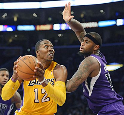 Dwight Howard, shooting against Sacramento's DeMarcus Cousins, finishes with 19 points, 12 rebounds and four blocks. (US Presswire)