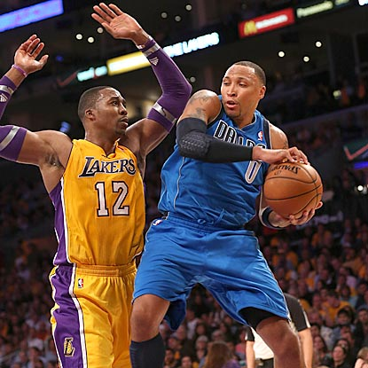 Shawn Marion (0), one of six Mavericks to score in double figures, also grabs nine rebounds to help defeat the Lakers.  (Getty Images)