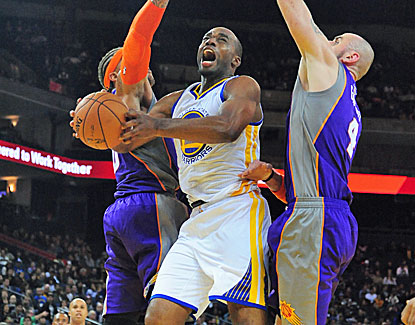 Carl Landry takes over in the 4th quarter for the Warriors against the Phoenix Suns. (US Presswire)