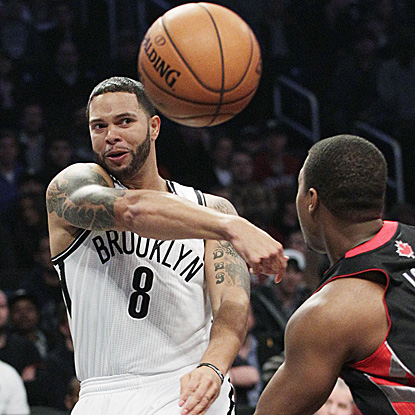 Deron Williams scores 19 points and adds nine assists for the Nets in their first game in Brooklyn. (AP)