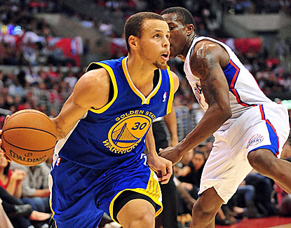 Stephen Curry not only scores 23 points for the Warriors, but he takes a key charge late. (US Presswire)