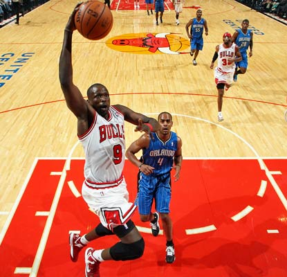 Luol Deng scores 15 of his 23 points in the second half to help the Bulls edge the Magic in Chicago.  (US Presswire)
