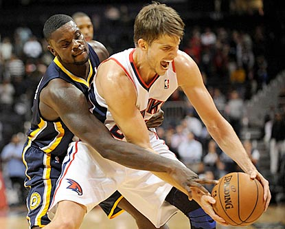 Lance Stephenson defends Kyle Korver, who later scores eight consecutive points during Atlanta's decisive run.  (US Presswire)