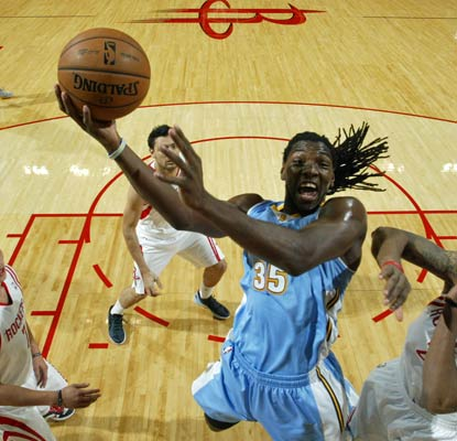 Kenneth Faried is relentless against the Rockets with 16 points and 16 rebounds for the Nuggets.   (Getty Images)