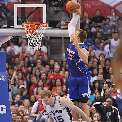 Matt Bonner knows better than to contest a Blake Griffin dunk, one of three the big guy has in the fourth quarter.  (US Presswire)