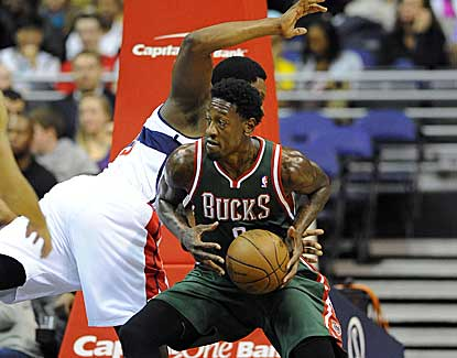 Bucks center Larry Sanders drives to the basket past Washington's Kevin Seraphin. (US Presswire)