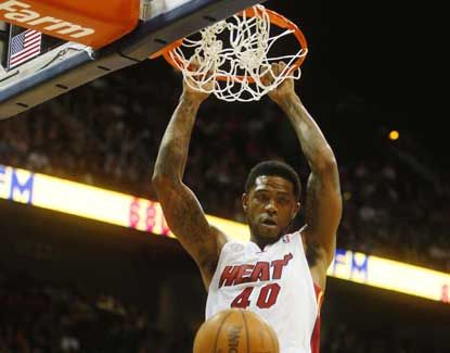 Miami's Udonis Haslem throws down a dunk in the Heat's 95-89 win over Atlanta. (US Presswire)